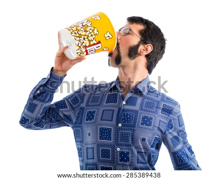 Vintage young man eating popcorn