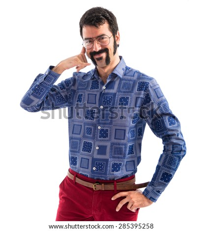 Vintage young man making phone gesture  - stock photo