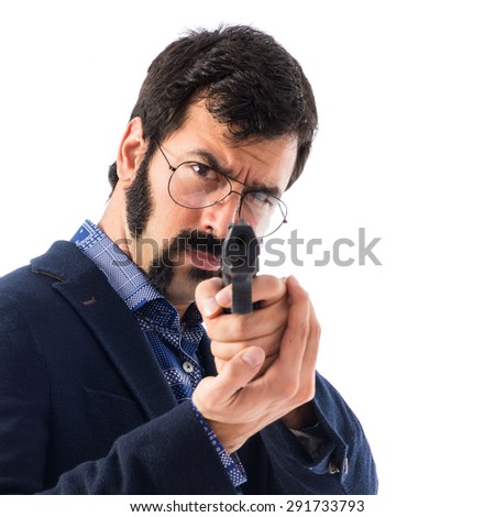 Vintage young man shooting with a pistol