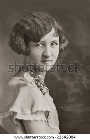 Vintage Young Woman with Corsage - stock photo