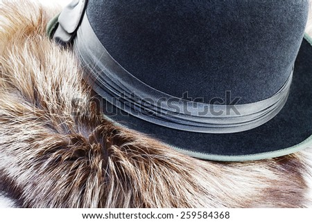 Vintagel hat-bowler on silver fox fur - stock photo