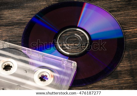 vinyl disc and cassette tapes on the wooden table