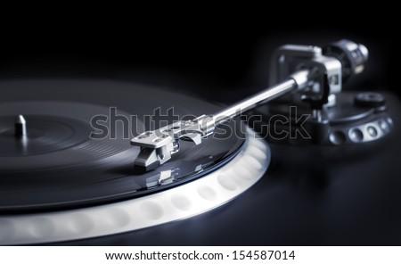 vinyl laying on a record player - nightclubbing, dj etc. - stock photo