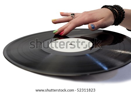 Vinyl music record with a hand on it