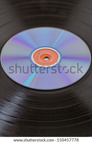 vinyl record  disk and CD (Compact disk) on white background - stock photo