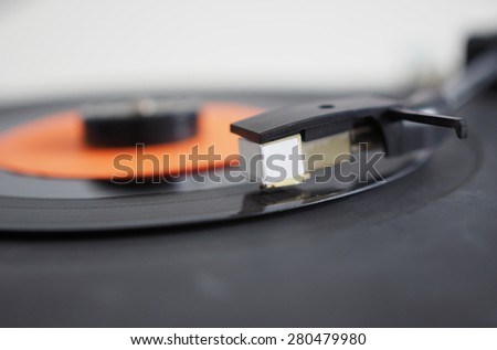 Vinyl record on a turntable record player, single 45rpm disc - stock photo