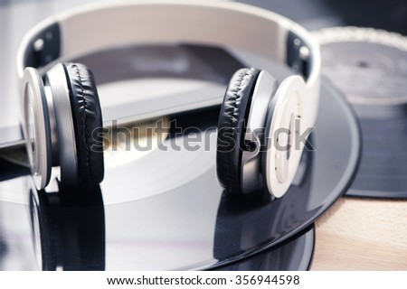 Vinyl record player headphones and tablet. Music concept - stock photo
