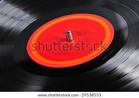 Vinyl record spinning on turntable close up - stock photo