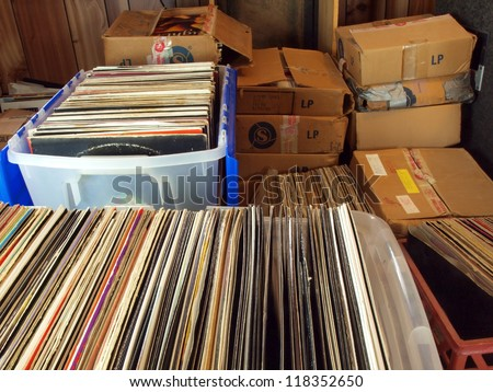 vinyl records stored in containers and boxes - stock photo