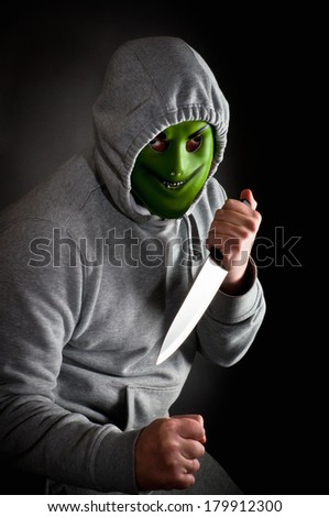 Violent gang member with a knife - stock photo