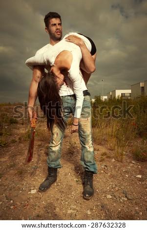 Violent man and victim - stock photo