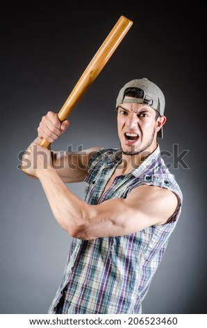 Violent man with baseball bat and hat - stock photo