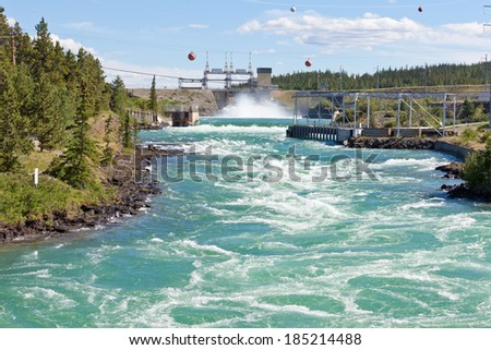 Violent white water in spillway of hydro-electric power plant of the small scale hydro station at Whitehorse, Yukon Territory, Canada - stock photo