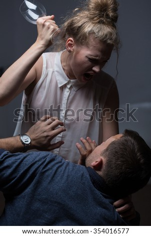 Violent young wife beating her terrified husband