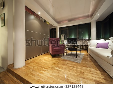 violet armchair in modern apartmet interior - stock photo