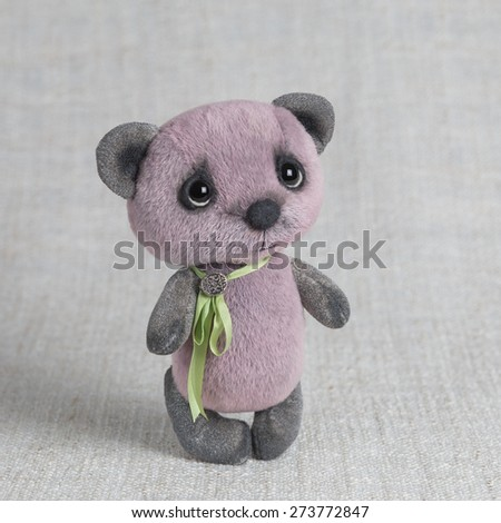 Violet artist Teddy bear with green ribbon