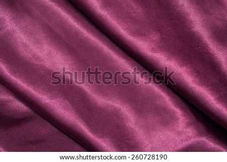violet background abstract cloth of wavy folds of silk texture satin or velvet material or design of elegant curves purple material - stock photo