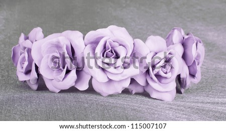 violet beige rose in the wedding crown with pink the centers fresh from a cold porcelain on the grey fabrics pearl tint