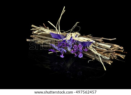 violet bouquet with purple satin ribbon with black reflection