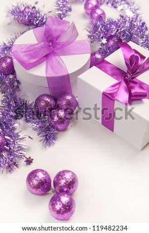 violet christmas present on white background - stock photo