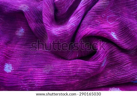 violet cotton material - close up of printed textile - stock photo