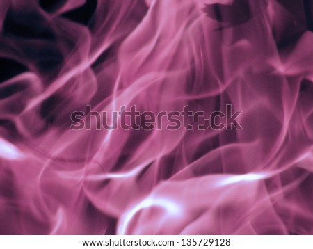 Violet flame isolated on black, background - stock photo