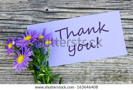 Violet flowers and card with lettering thank you/thank you/english - stock photo