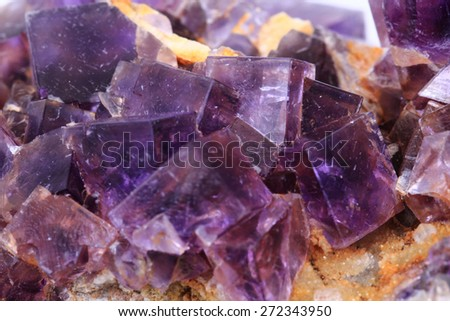 violet fluorite cubes as natural mineral background - stock photo