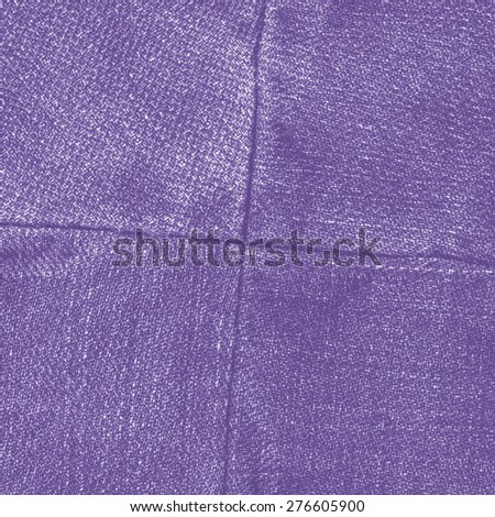 violet jeans texture,seams in shape of the cross - stock photo