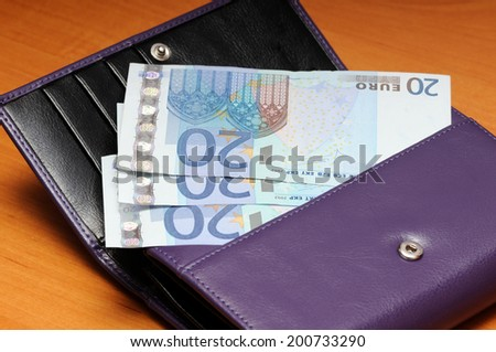 violet  leather  purse and euro  banknotes - stock photo