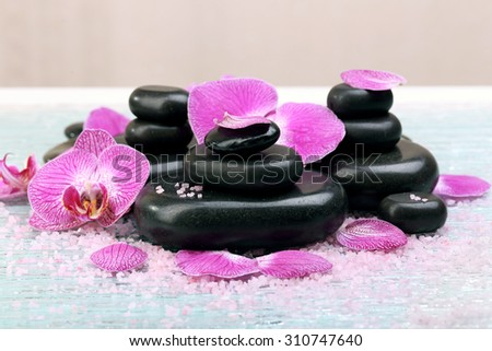 Violet orchid and zen stones close-up