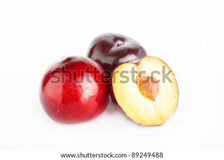 Violet plums: whole and  halve isolated on the white background