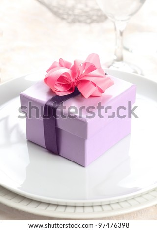 violet Present or Gift Box with a pink bow and a lilac ribbon - stock photo