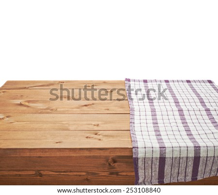 Violet tablecloth or towel over the surface of a brown wooden table, composition isolated over the white background - stock photo