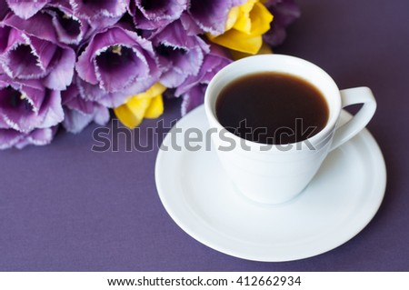 Violet tulips and cup of coffee