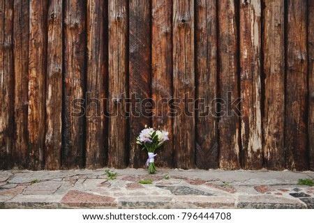 Violet wedding bouquet on a wooden background. White and purple Flower bouquet.