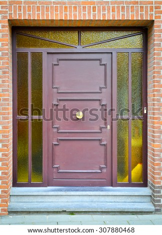 Violet wooden front door with yellow glass windows - stock photo