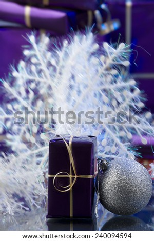 violet xmas presents, white snow flake and silver ball  - stock photo
