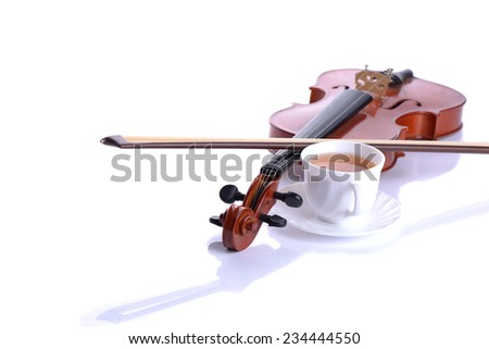 Violin and bow with white cup on white background. Tea time. - stock photo