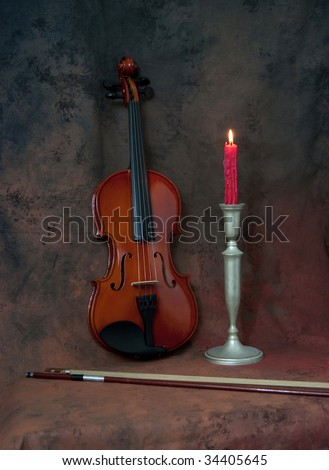 Violin and candle - stock photo