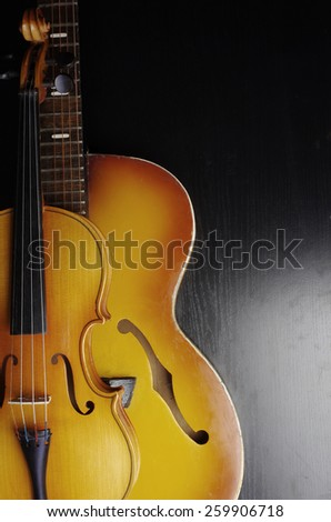 Violin and guitar on black
