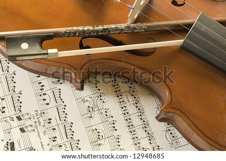 violin and part of a music sheet - stock photo