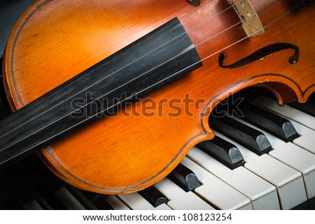 Violin and piano keyboard closeup part fot music background - stock photo