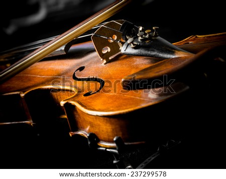 violin close up on black background - stock photo