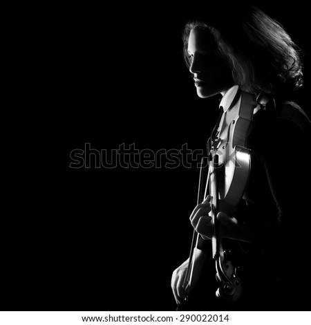Violin concert party. Silhouette of violinist on black background. Black and white artistic photo - stock photo