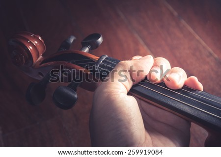 Violin in Violinist 's hand,vintage filtered. - stock photo