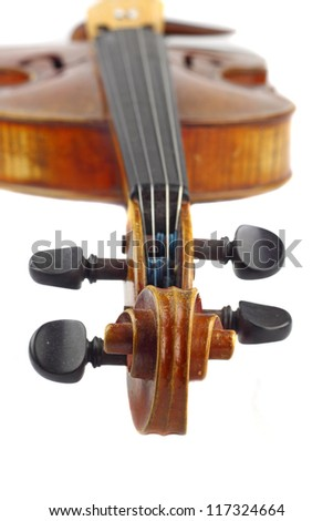 Violin macro closeup. View on scroll and pegbox with neck and fingerboard in background