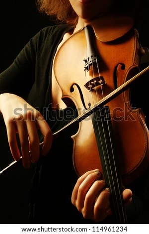 Violin musical instrument violinist hands. Classical musician orchestra music playing - stock photo