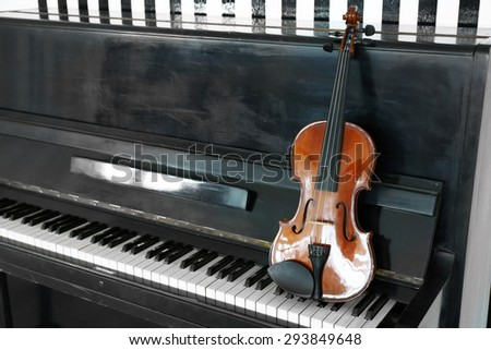 Violin on piano background