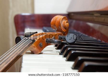 Violin on the piano - stock photo